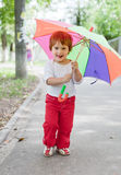 Girl  with umbrella in summer street Stock Images