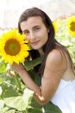 Girl with umbrella in a sunflower field. Portrait of a beautifull girl in a sunflower field with an umbrella Stock Photo