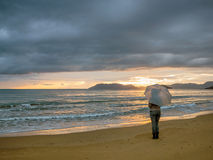 Girl with umbrella in the sunset Stock Image