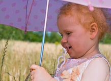 Girl with umbrella and teat Royalty Free Stock Photography