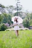 Girl with umbrella walking Stock Image