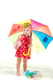 Girl with an umbrella on is white a background Royalty Free Stock Photography
