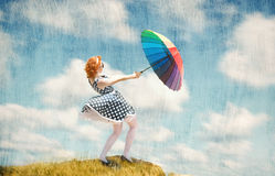 Girl with an umbrella in the wind Royalty Free Stock Photos