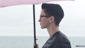 Girl with an umbrella stock footage