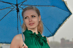 Girl with umbrella Stock Images