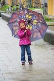 Girl with umrella Stock Photography