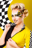 Girl unbuttons racer shape. Royalty Free Stock Photo
