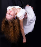 Girl unconscious. Redhead girl in white dress unconscious Royalty Free Stock Photo