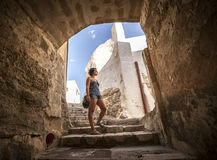 Girl under a arc in an old village Royalty Free Stock Photo