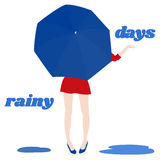 Girl under a big blue umbrella. In a red dress and blue shoes. Rainy days Royalty Free Stock Image