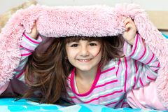 Girl under the blanket Stock Photos