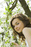 Girl under blooming tree Royalty Free Stock Image