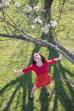 Girl under blossoming almond tree Royalty Free Stock Images