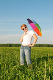 Girl under blue sky with umbrella Stock Photo
