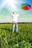 Girl under blue sky with umbrella Stock Photo