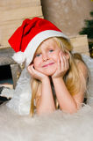 The girl under the Christmas fir-tree Royalty Free Stock Photo