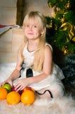 The girl under the Christmas fir-tree Royalty Free Stock Photos