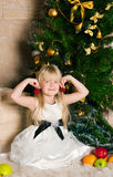 The girl under the Christmas fir-tree Stock Image