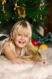 The girl under the Christmas fir-tree Royalty Free Stock Photography