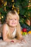 The girl under the Christmas fir-tree Stock Photos