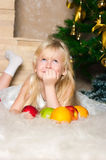 The girl under the Christmas fir-tree Royalty Free Stock Image
