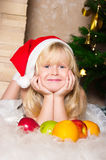 The girl under the Christmas fir-tree Stock Images