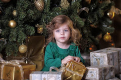 Girl  under the Christmas tree. The girl with a gift under the Christmas tree Royalty Free Stock Photos