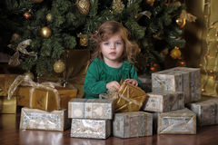 Girl  under the Christmas tree Royalty Free Stock Photography