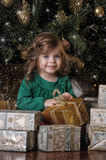 Girl  under the Christmas tree. The girl with a gift under the Christmas tree Stock Images