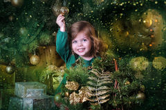 Girl  under the Christmas tree. The girl with a gift under the Christmas tree Stock Image