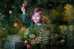 Girl  under the Christmas tree Stock Photos