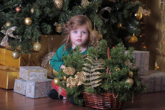 Girl  under the Christmas tree Stock Photo