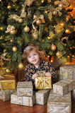 Girl under the Christmas tree