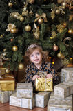 Girl  under the Christmas tree Stock Image