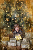 Girl  under the Christmas tree. The girl with a gift under the Christmas tree Royalty Free Stock Photo