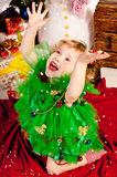 A girl under the Christmas tree with gifts Stock Photo