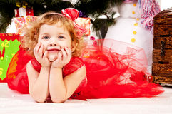 A girl under the Christmas tree with gifts Royalty Free Stock Photography