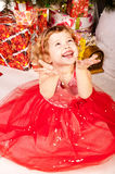 A girl under the Christmas tree with gifts Royalty Free Stock Images