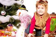 A girl under the Christmas tree with gifts Royalty Free Stock Photo