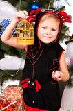 A girl under the Christmas tree with gifts Stock Photos