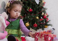 Girl under Christmas tree Stock Photo