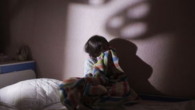 Girl under the covers in the night afraid of ghosts. nightmares. Girl under the covers in the night afraid of ghosts stock footage