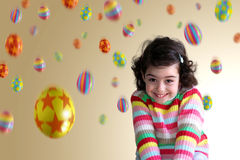 Girl Under Eggs Stock Images