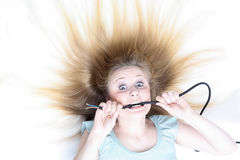 Girl under electricity Royalty Free Stock Photography