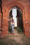 Girl under Gothic arch Stock Photos