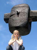 Girl under large hammer royalty free stock photos