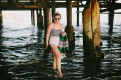 Girl under pier on beach. In San Diego Southern California Royalty Free Stock Image