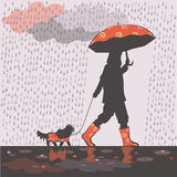 Girl under rain 1. Girl is taking small dog for a walk under the rain Royalty Free Stock Photos