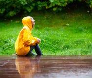 Girl under rain Stock Photos