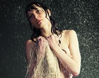 Girl under a rain Stock Images